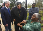 FILE - In this Feb. 21, 2019, file photo, former Vice President Al Gore, left, founder of the Climate Reality Project, and the Rev. William Barber II, president of the Repairers of the Breach, visit Lowndes County resident Charlie Mae Holcombe to talk about the failing wastewater sanitation system at her home in Hayneville, Ala. An anti-poverty coalition led by Barber is scheduled to hold a virtual march Saturday. The Mass Poor People's Assembly & Moral March on Washington aims to build upon the nation's principles to pursue solutions to poverty — something advocates say is getting especially severe in rural areas. (AP Photo/Julie Bennett, File)
