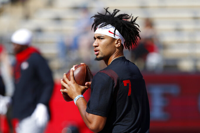 Ohio State quarterback C.J. Stroud (7) warms-up before an NCAA college football game against Rutgers, Saturday, Oct. 2, 2021, in Piscataway, N.J. (AP Photo/Noah K. Murray)