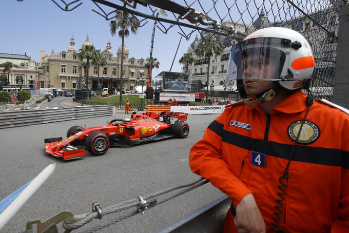 Ferrari driver Charles Leclerc of Monaco steers his car past the casino during the second practice session at the Monaco racetrack, in Monaco, Thursday, May 23, 2019. The Formula one race will be held on Sunday. (AP Photo/Luca Bruno)