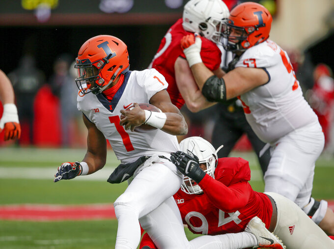 Martinez leads Cornhuskers past turnover-prone Illini 54-35