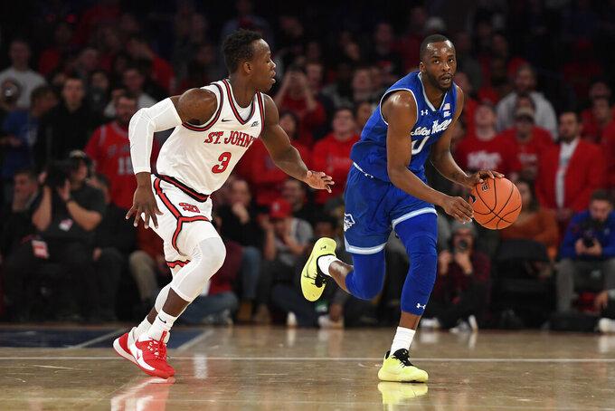 Seton Hall guard Quincy McKnight (0) dribbles the ball against St. John's guard Rasheem Dunn (3) during the first half of an NCAA college basketball game in New York, Saturday, Jan. 18, 2020. (AP Photo/Sarah Stier)