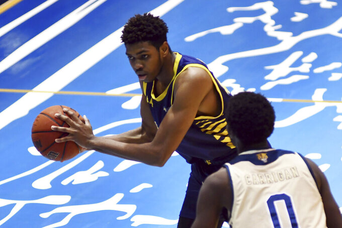 Carver College forward Lawrence Simmons tries to get past FIU forward Dimon Carrigan during the second half of an NCAA college basketball game against Monday, Dec. 21, 2020, in Miami. (AP Photo/Gaston De Cardenas)