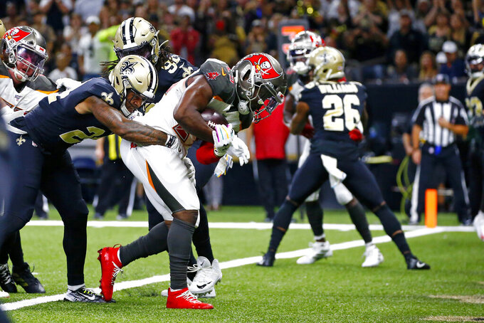 Tampa Bay Buccaneers running back Peyton Barber (25) carries into the end zone for a touchdown in the second half of an NFL football game against the New Orleans Saints in New Orleans, Sunday, Oct. 6, 2019. (AP Photo/Butch Dill)