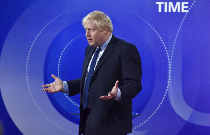 Britain's Prime Minister Boris Johnson gestures, during a BBC Question Time live election debate, in Sheffield, England, Friday, Nov. 22, 2019. ( Jeff Overs/BBC via AP)