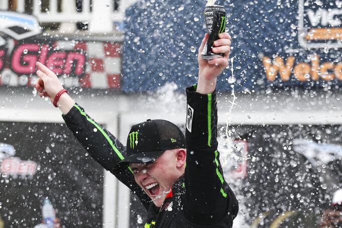 Ty Gibbs celebrates winning the NASCAR Xfinity Series auto race at Watkins Glen International in Watkins Glen, N.Y., Saturday, Aug. 7, 2021. (AP Photo/Joshua Bessex)