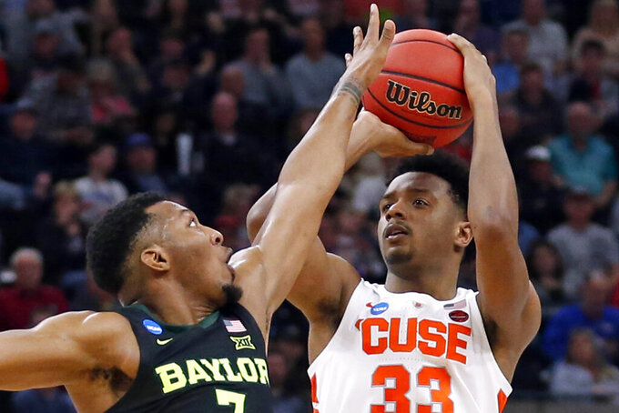 FILE - In this March 21, 2019, file photo, Syracuse forward Elijah Hughes (33) shoots as Baylor guard King McClure (3) defends during the first half in a first-round game in the NCAA college basketball tournament in Salt Lake City.  The Orange received three votes in the AP Top 25 preseason poll and the players say they like being the underdog. Syracuse opens its season at home against defending national champion Virginia on Nov. 6. (AP Photo/Rick Bowmer, File)