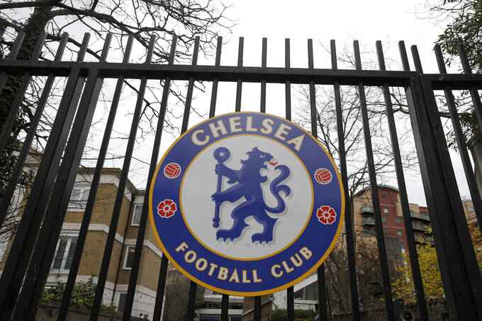 A sign on the gate at Chelsea's Stamford Bridge stadium, as the English Premier League is suspended until April 3, in London, Friday, March 13, 2020. Chelsea's Callum Hudson-Odoi has tested positive for coronavirus, For most people, the new coronavirus causes only mild or moderate symptoms, such as fever and cough. For some, especially older adults and people with existing health problems, it can cause more severe illness, including pneumonia.(AP Photo/Kirsty Wigglesworth)