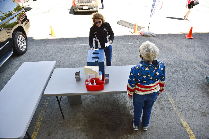 Voters drop off their ballots Tuesday outside the City-County Building during Montana's primary election Tuesday, June 2, 2020 in Helena. Montana's June 2 primary is being held by mail because of the coronavirus.  (Thom Bridge/Independent Record via AP)