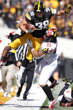 Iowa tight end T.J. Hockenson (38) is tackled by Maryland linebacker Tre Watson (33) after making a reception during the second half of an NCAA college football game, Saturday, Oct. 20, 2018, in Iowa City, Iowa. Iowa won 23-0. (AP Photo/Charlie Neibergall)