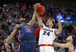 Gonzaga forward Corey Kispert (24) and Fairleigh Dickinson center Oscar Okeke (15) vie for control of a rebound during the first half of a first-round game in the NCAA men's college basketball tournament Thursday, March 21, 2019, in Salt Lake City. (AP Photo/Rick Bowmer)