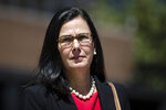 Assistant United States Attorney Michelle Morgan walks to a news conference outside the federal courthouse in Philadelphia after former Reading Mayor Vaughn Spencer was sentenced to eight years in prison for trading city contracts for campaign contributions on Wednesday, April 24, 2019. (AP Photo/Matt Rourke)