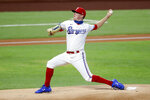 Texas Rangers starting pitcher Kolby Allard throws to the Los Angeles Angels in the first inning of a baseball game in Arlington, Texas, Saturday, Aug. 8, 2020. (AP Photo/Tony Gutierrez)