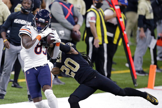 Chicago Bears wide receiver Javon Wims (83) pulls in a pass against New Orleans Saints cornerback Janoris Jenkins in the first half of an NFL wild-card playoff football game in New Orleans, Sunday, Jan. 10, 2021. (AP Photo/Butch Dill)