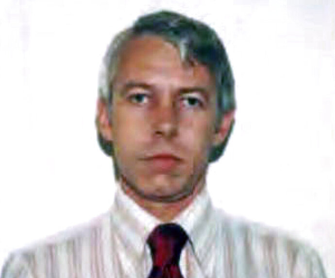 FILE – This undated file photo shows a photo of Dr. Richard Strauss, an Ohio State University team doctor employed by the school from 1978 until his 1998 retirement. More Ohio State alumni are suing the university over how school officials dealt with a team doctor recently found to have sexually abused at least 177 young men over two decades. (Ohio State University via AP, File)