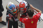 AlfaTauri driver Pierre Gasly of France, center, celebrates with Ferrari driver Charles Leclerc of Monaco, right, and Haas driver Romain Grosjean of France after winning the Italian Formula One Grand Prix, at the Monza racetrack in Monza, Italy, Sunday Sept. 6, 2020. (AP Photo/Luca Bruno, Pool)
