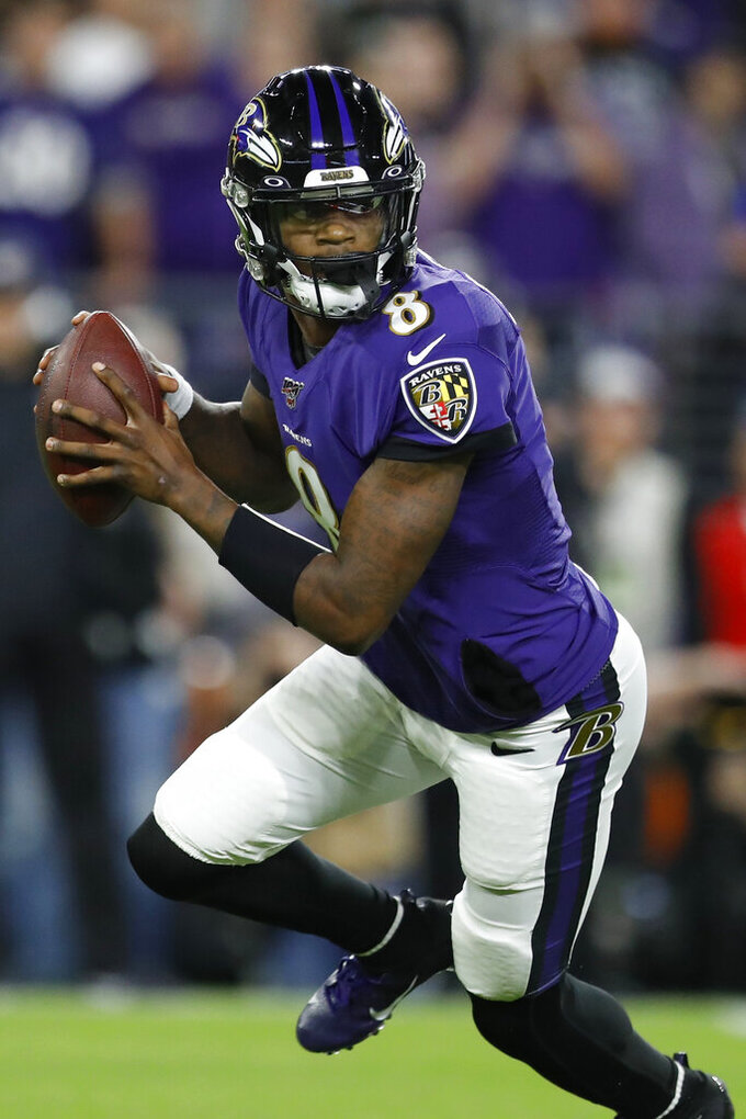 Baltimore Ravens quarterback Lamar Jackson (8) runs out of the pocket against the Tennessee Titans during the first half an NFL divisional playoff football game, Saturday, Jan. 11, 2020, in Baltimore. (AP Photo/Julio Cortez)