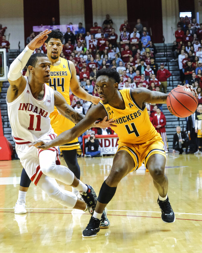 Wichita State guard Samajae Haynes-Jones (4) moves around Indiana guard Devonte Green (11) in the first half of an NCAA college basketball game in the third round of the NIT tournament in Bloomington, Ind., Tuesday, March 26, 2019. Wichita State won 73-63. (AP Photo/AJ Mast)