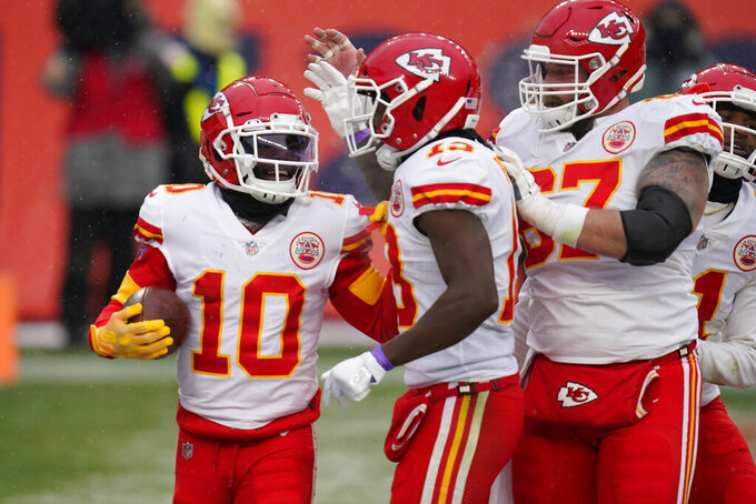 Kansas City Chiefs wide receiver Tyreek Hill (10) reacts with teammates after scoring a touchdown during the second half of an NFL football game against the Denver Broncos, Sunday, Oct. 25, 2020, in Denver. (AP Photo/David Zalubowski)