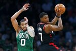 Toronto Raptors' Kyle Lowry (7) passes off next to Boston Celtics' Jayson Tatum (0) during the first half of an NBA basketball game in Boston, Friday, Oct. 25, 2019. (AP Photo/Michael Dwyer)