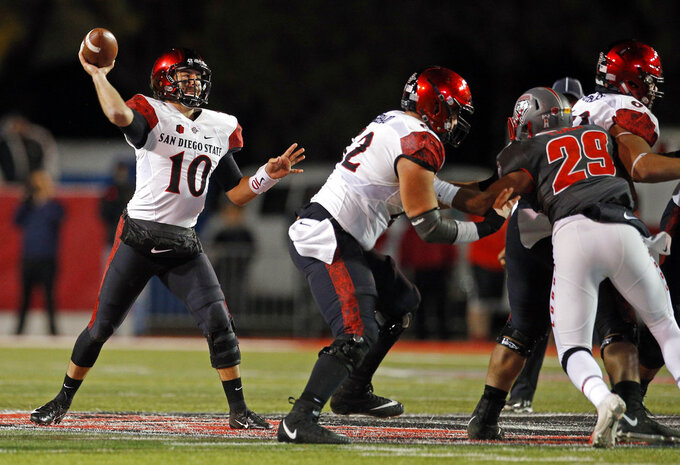 San Diego State quarterback Christian Chapman (10) throws during the second half of an NCAA college football game against New Mexico in Albuquerque, N.M., Saturday, Nov. 3, 2018. San Diego State won 31-23. (AP Photo/Andres Leighton)