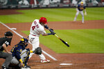 St. Louis Cardinals' Yadier Molina singles for his 2,000th career hit during the seventh inning of a baseball game against the Milwaukee Brewers Thursday, Sept. 24, 2020, in St. Louis. (AP Photo/Jeff Roberson)