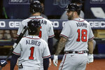 Atlanta Braves' Matt Adams (18) celebrates his three-run home run off Tampa Bay Rays relief pitcher Jalen Beeks with Freddie Freeman (5) and Ozzie Albies (1) during the sixth inning of a baseball game Monday, July 27, 2020, in St. Petersburg, Fla. (AP Photo/Chris O'Meara)