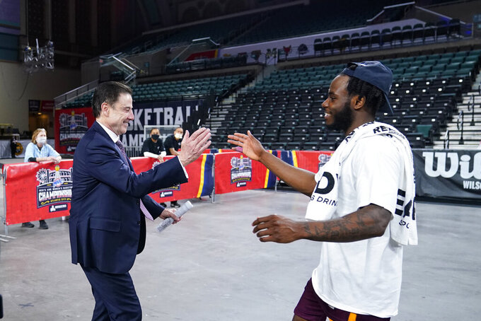 Iona head coach Rick Pitino, left, and Asante Gist celebrate after winning an NCAA college basketball game against Fairfield during the finals of the Metro Atlantic Athletic Conference tournament, Saturday, March 13, 2021, in Atlantic City, N.J. (AP Photo/Matt Slocum)