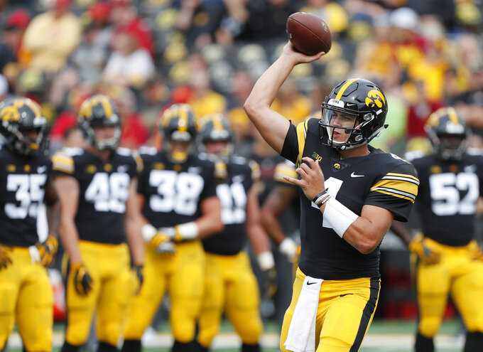 Iowa quarterback Nate Stanley warms up before an NCAA college football game, Saturday, Sept. 8, 2018, in Iowa City, Iowa. (AP Photo/Matthew Putney)