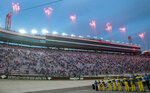 Fans stand on the front stretch as fireworks go off prior to the start of the Bass Pro Shops NRA Night Race Saturday at Brisol Motor Speedway. (David Crigger/Bristol Herald Courier via AP)