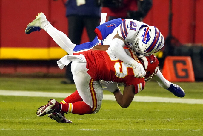 Buffalo Bills safety Jordan Poyer (21) tackles Kansas City Chiefs running back Clyde Edwards-Helaire during the second half of the AFC championship NFL football game, Sunday, Jan. 24, 2021, in Kansas City, Mo. (AP Photo/Charlie Riedel)