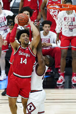 Ohio State's Justice Sueing (14) shoots against Illinois's Da'Monte Williams (20) during the second half of an NCAA college basketball championship game at the Big Ten Conference tournament, Sunday, March 14, 2021, in Indianapolis. (AP Photo/Darron Cummings)