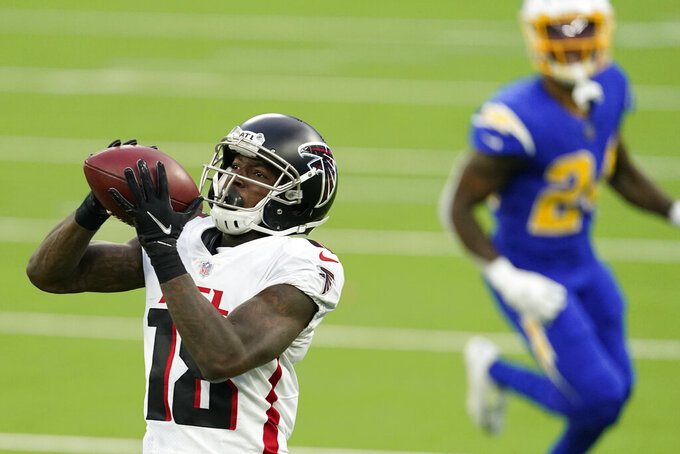 Atlanta Falcons wide receiver Calvin Ridley makes a catch against the Los Angeles Chargers during the first half of an NFL football game Sunday, Dec. 13, 2020, in Inglewood, Calif. (AP Photo/Ashley Landis)