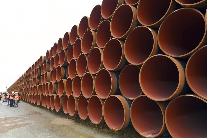 "FILE - In this May 8, 2017 file photo steel pipes for the North Stream 2 pipeline are stacked in Mukran harbour in Sassnitz, Germany. Three Republican senators have warned operators of a small German port that they face ""crushing"" sanctions for allegedly providing supplies to vessels involved in a Russian pipeline project. The letter by Sen. Ted Cruz, Sen. Tom Cotton and Sen. Ron Johnson targets Mukran port located in German Chancellor Angela Merkel's constituency on the Baltic Sea island of Ruegen.  (Stefan Sauer/dpa via AP, File)"