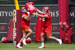 """FILE - Kansas City Chiefs center Creed Humphrey, right, and offensive lineman Wyatt Miller, left, participate in a drill during the NFL football team's minicamp in Kansas City, Mo., in this Wednesday, June 16, 2021, file photo. With only a few practices remaining before breaking training camp, the Kansas City Chiefs take a business trip on Saturday to visit the San Francisco 49ers. For quarterback Patrick Mahomes, the results in this first preseason outing matter less than the process. """"You always like a score, but at the end of the day, I think if the communication, the procedures of in and out of the huddle with so many new guys, especially on that offensive line, I think that would be a win for me just throughout this first game,"""" Mahomes said. (AP Photo/Charlie Riedel, File)"""