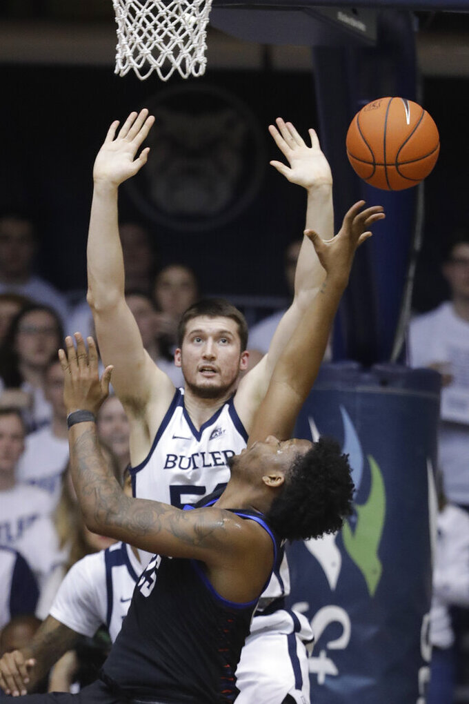 DePaul's Femi Olujobi, front, shoots against Butler's Nate Fowler during the first half of an NCAA college basketball game, Saturday, Feb. 16, 2019, in Indianapolis. (AP Photo/Darron Cummings)