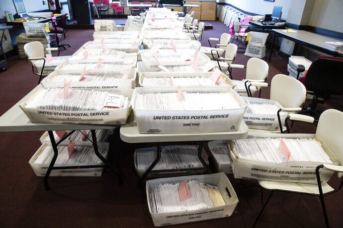 Processed mail-in ballots are seen at the Chester County Voter Services office in West Chester, Pa., prior to the primary election, Thursday, May 28, 2020. (AP Photo/Matt Rourke)