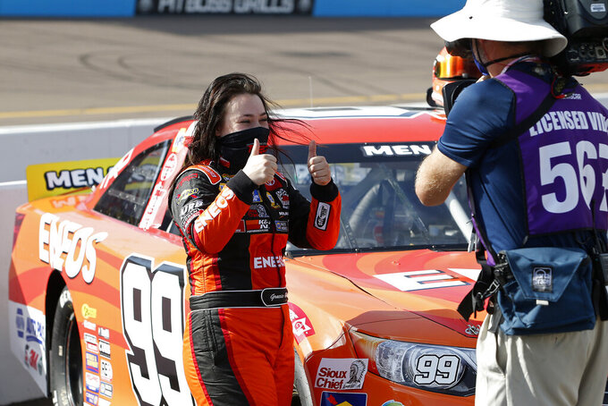 Gracie Trotter, left, gives a thumbs-up to the television crew on pit road prior to an ARCA Series auto race at Phoenix Raceway, Saturday, Nov. 7, 2020, in Avondale, Ariz. (AP Photo/Ralph Freso)