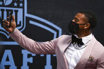 Alabama cornerback Patrick Surtain II holds up his phone as he appears on the Red Carpet at the Rock & Roll Hall of Fame before NFL football draft, Thursday, April 29, 2021, in Cleveland. (AP Photo/David Dermer, Pool)