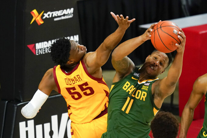 Baylor guard Mark Vital (11) fights for a rebound with Iowa State guard Darlinstone Dubar (55) during the first half of an NCAA college basketball game, Saturday, Jan. 2, 2021, in Ames, Iowa. (AP Photo/Charlie Neibergall)