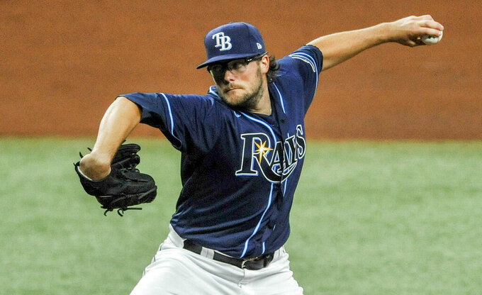 Tampa Bay Rays starter Josh Fleming throws to a Texas Rangers batter during the fourth inning of a baseball game Wednesday, April 14, 2021, in St. Petersburg, Fla. (AP Photo/Steve Nesius)