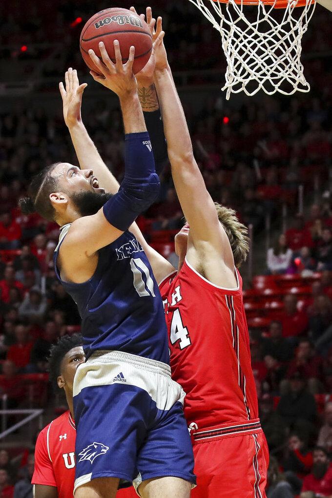 Utah center Jayce Johnson (34) blocks the shot of Nevada forward Cody Martin (11) during the first half of an NCAA college basketball game, Saturday, Dec. 29, 2018, in Salt Lake City. (AP Photo/Chris Nicoll)