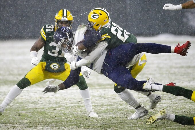 Green Bay Packers' Darnell Savage stops Tennessee Titans' Malcolm Butler during the first half of an NFL football game Sunday, Dec. 27, 2020, in Green Bay, Wis. (AP Photo/Mike Roemer)