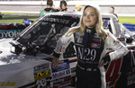 Natalie Decker stands by her truck before the NASCAR Truck Series auto race at Daytona International Speedway, Friday, Feb. 15, 2019, in Daytona Beach, Fla. (AP Photo/John Raoux)