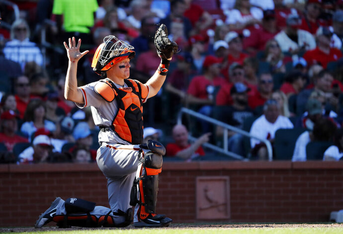 File-This Sept. 23, 2018, file photo shows San Francisco Giants catcher Nick Hundley taking up his position during the seventh inning of a baseball game against the St. Louis Cardinals  in St. Louis. The Oakland Athletics added depth at catcher on Monday, Feb. 11, 2019, agreeing to a minor league contract with Hundley. If added to the 40-man roster, the 35-year-old would get a one-year contract paying a $1.25 million salary while in the major leagues.  (AP Photo/Jeff Roberson, File)