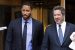 Former assistant basketball coach for the University of Southern California Tony Bland, left, and his attorney Jeffrey Lichtman, leave federal court in New York, Wednesday, June 5, 2019. Bland was the first of four ex-coaches charged with crimes to plead guilty to bribery conspiracy. He was sentenced to 100 hours of community service and two years of probation. (AP Photo/Richard Drew)