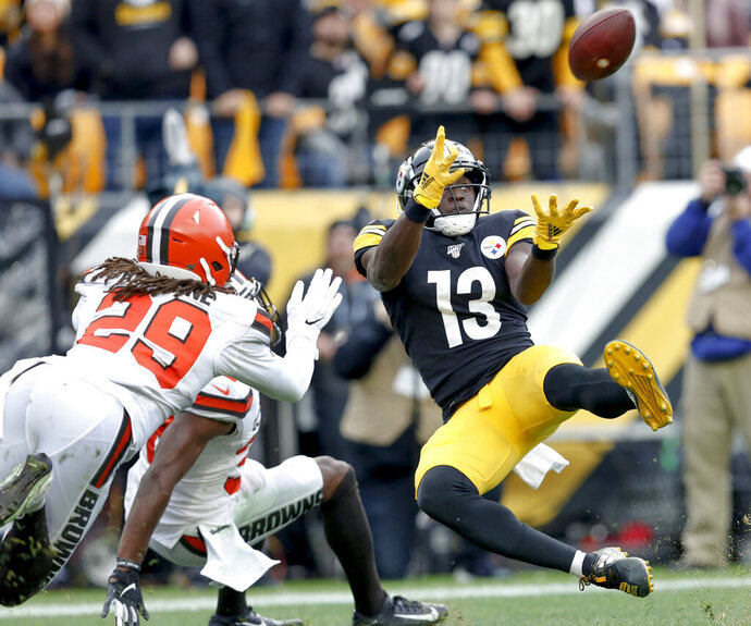 Pittsburgh Steelers wide receiver James Washington (13) makes a touchdown catch in front pop Cleveland Browns defensive back Sheldrick Redwine (29) during the first half of an NFL football game, Sunday, Dec. 1, 2019, in Pittsburgh. (AP Photo/Don Wright)