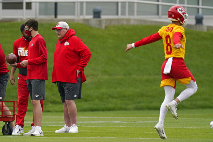 Kansas City Chiefs head coach Andy Reid, second from right, watches an NFL football rookie minicamp Saturday, May 15, 2021, in Kansas City, Mo. (AP Photo/Charlie Riedel)