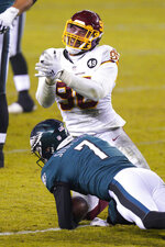 Washington Football Team's Montez Sweat (90) reacts after sacking Philadelphia Eagles' Nate Sudfeld (7) during the second half of an NFL football game, Sunday, Jan. 3, 2021, in Philadelphia. (AP Photo/Chris Szagola)