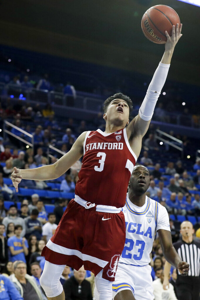 Stanford guard Tyrell Terry shoots as UCLA guard Prince Ali looks on during the first half of an NCAA college basketball game in Los Angeles, Wednesday, Jan. 15, 2020. (AP Photo/Chris Carlson)