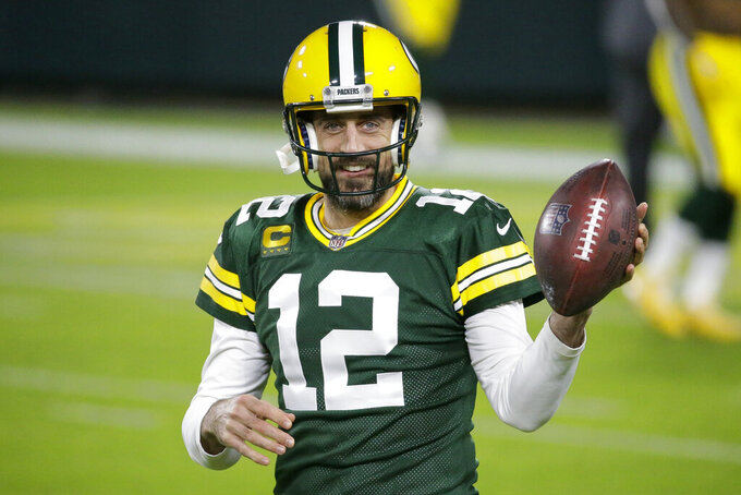 FILE - Green Bay Packers' Aaron Rodgers warms up before an NFL football game against the Chicago Bears in Green Bay, Wis., in this Sunday, Nov. 29, 2020, file photo. Rodgers is one of 32 players nominated for the seventh annual Art Rooney Sportsmanship Award, the NFL announced Thursday, Dec. 3, 2020. (AP Photo/Mike Roemer, File)